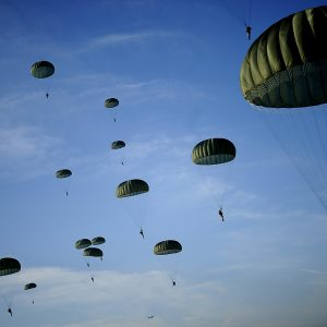 U.S. Army Soldiers with the 82nd Airborne Division descend under a parachute canopy to earn foreign jump wings during the 11th Annual Randy Oler Memorial Operation Toy Drop at Fort Bragg N.C., Dec. 6, 2008.  This year's event was hosted by the U.S. Army Civil Affairs and Psychological Operations Command (Airborne) USACAPOC (A), with support by XVIII Airborne Corps, Fort Bragg and 43rd Airlift Wing, Pope air Force Base to boost unit morale while assisting families in need over the holidays.  Over 1200 Soldiers donated a toy for a lottery ticket to win a chance to jump under a German or Irish Jumpmaster to earn their foreign jump wings. (U.S. Air Force photo by Tech. Sgt. Jeremy Lock/Released)