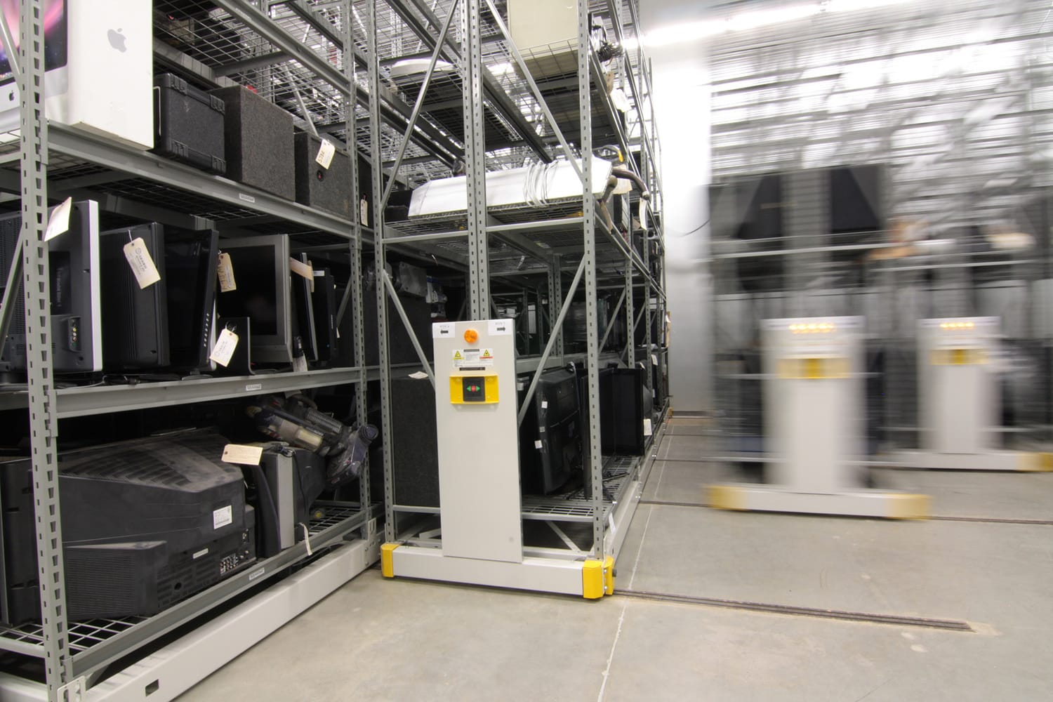 Powered industrial mobile shelving systems storing oversized evidence