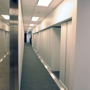 Wall of High Density Lateral Sliding Shelving at Law Firm