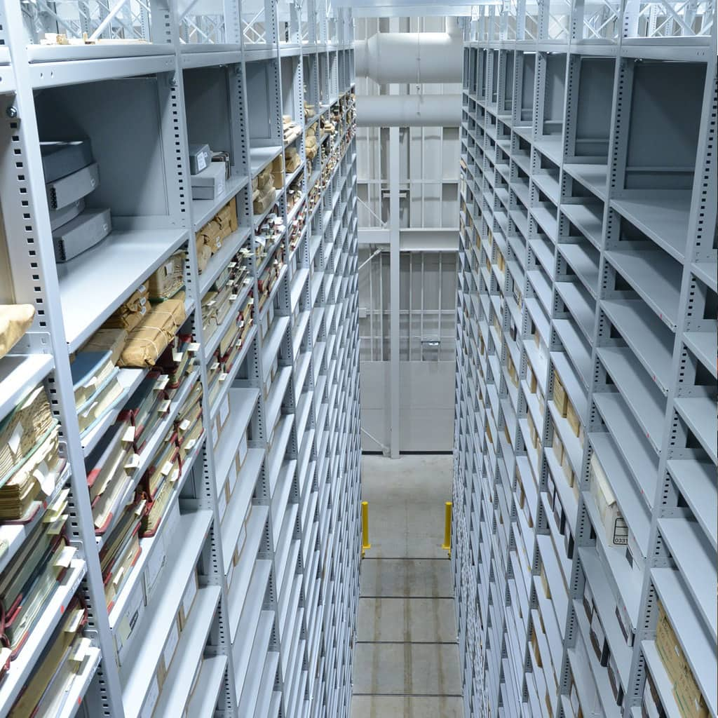 Off-site storage for library books on mobile high-bay system
