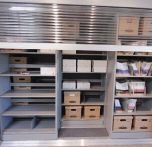 High-density lateral sliding storage with rolldown locking doors