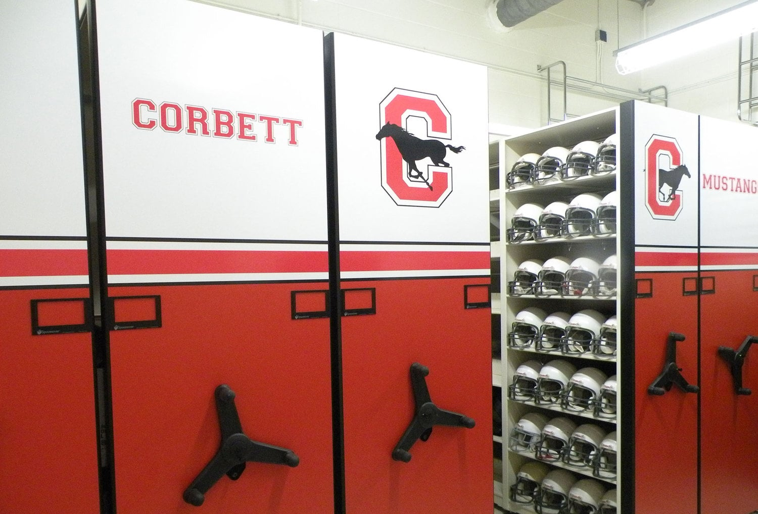 Athletic equipment storage on low profile mobile shelving system