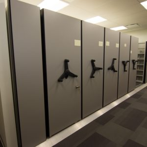Mechanical-assist low profile mobile shelving system in Finance Department