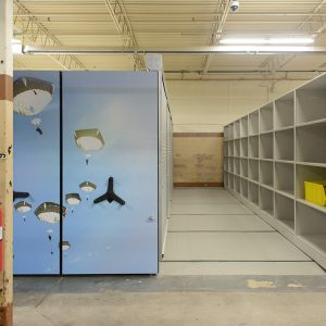 Movable shelving storing military gear