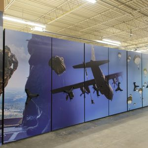 Mobile shelving system with custom end panel graphics in military storage facility