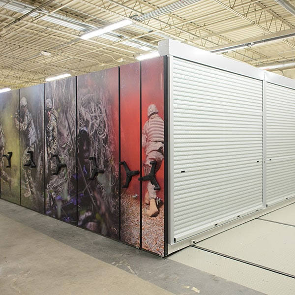 Movable shelving and tambour doors secure military gear
