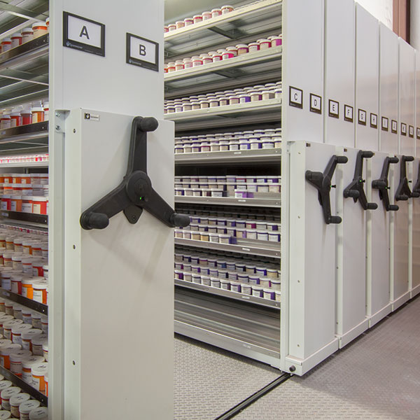 moveable shelving system storing ink sample bottles