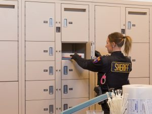 Pass-thru evidence storage lockers for packaged evidence