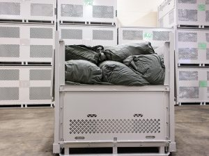Storage containers for bulk parachute storage