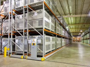 Powered mobile shelving stores parachute containers