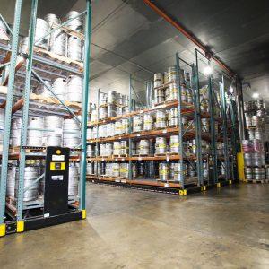 Kegs stored on high-density mobile shelving