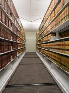 Cantilever shelving with custom end panels in law library