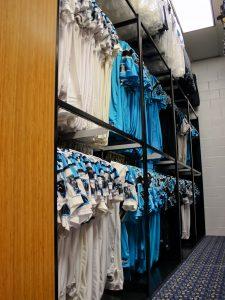 Shelving to store Carolina Panther football uniforms