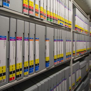 Sheet music organized using color-coding and open shelving