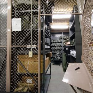 Military Gear Organized and Secured in Cages