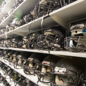 Shelving to store high school football helmets