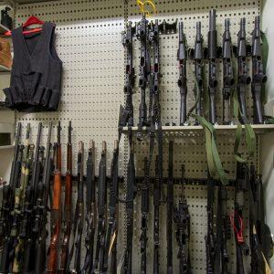 Long guns stored on Shelving