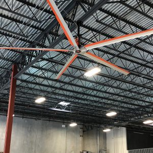 Warehouse space cooled by industrial fans