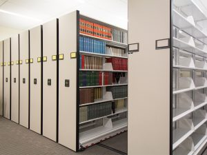 Powered mobile shelving in law library