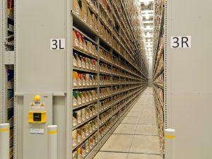 Looking down the aisle of a high-bay mobile shelving system