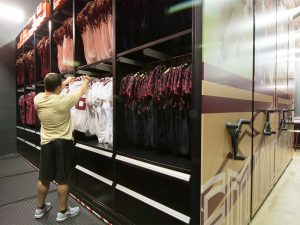 Mobile shelving stores football uniforms at Florida State