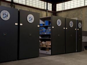 Powered mobile shelving system stores pharmaceutical supplies on military base