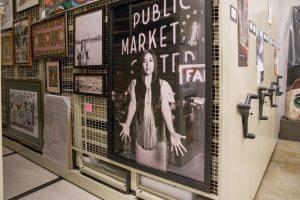 Framed art stored in compact mobile art rack
